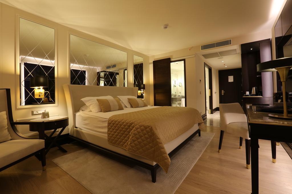 اتاق های هتل کاریزما دلوکس کوش آداسی