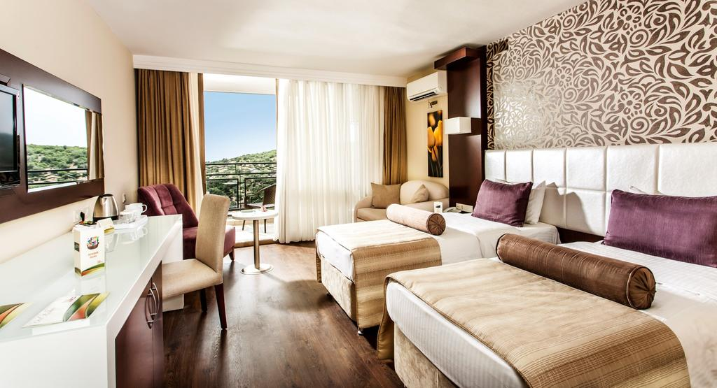 اتاق های هتل توسان بیچ کوش آداسی